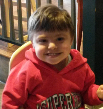 author's son in red sweatshirt, smiling