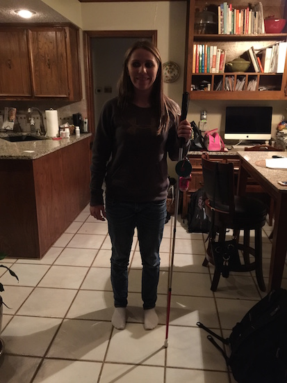 Brittany standing in the kitchen with her cane