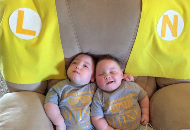two young boys lying on a couch