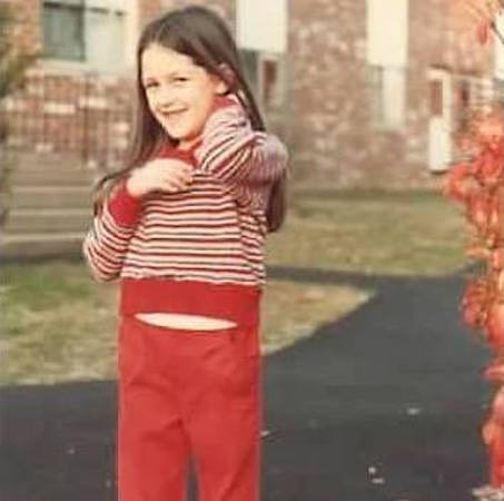 Girl in red striped sweater and red pants
