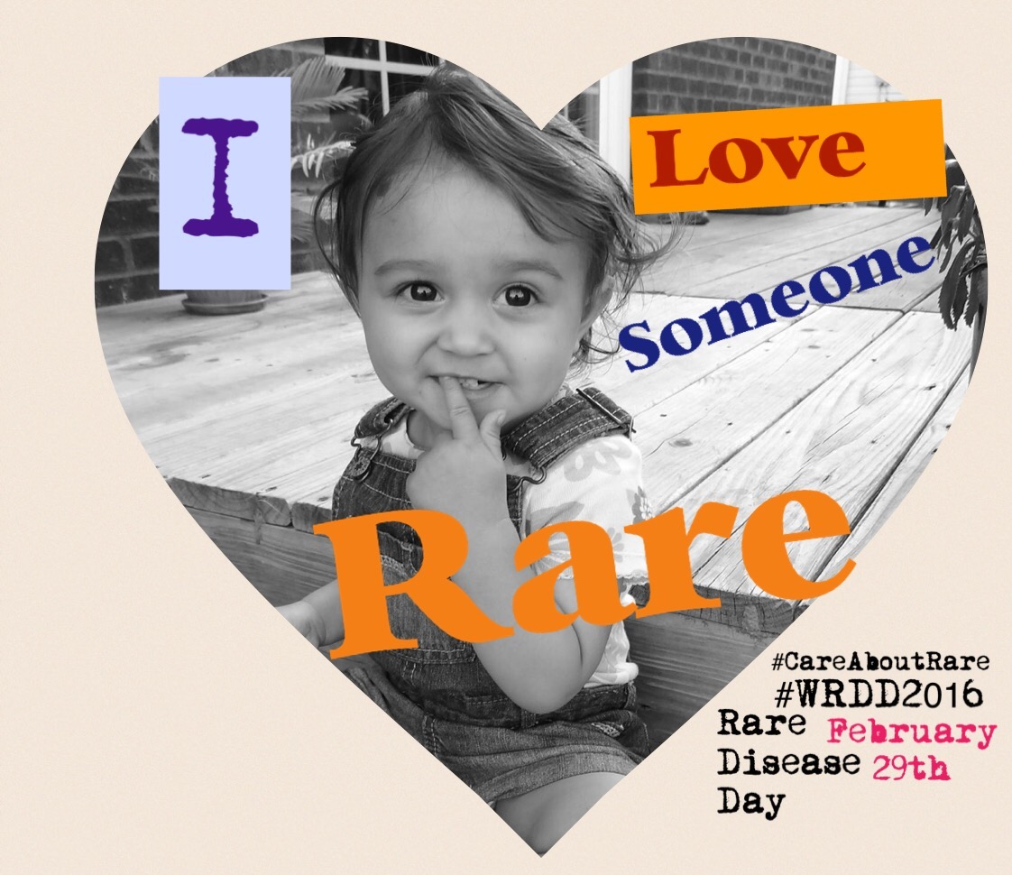 """A photo of Michelle's daughter with a heart around it and the words """"I love someone rare"""""""