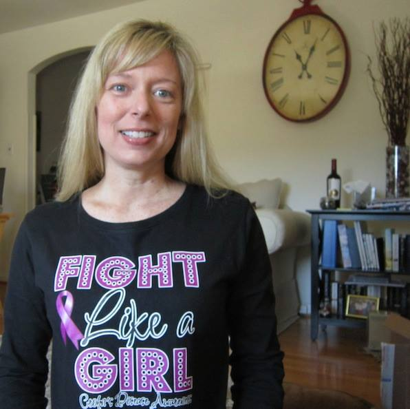 blonde woman wearing shirt that says fight like a girl