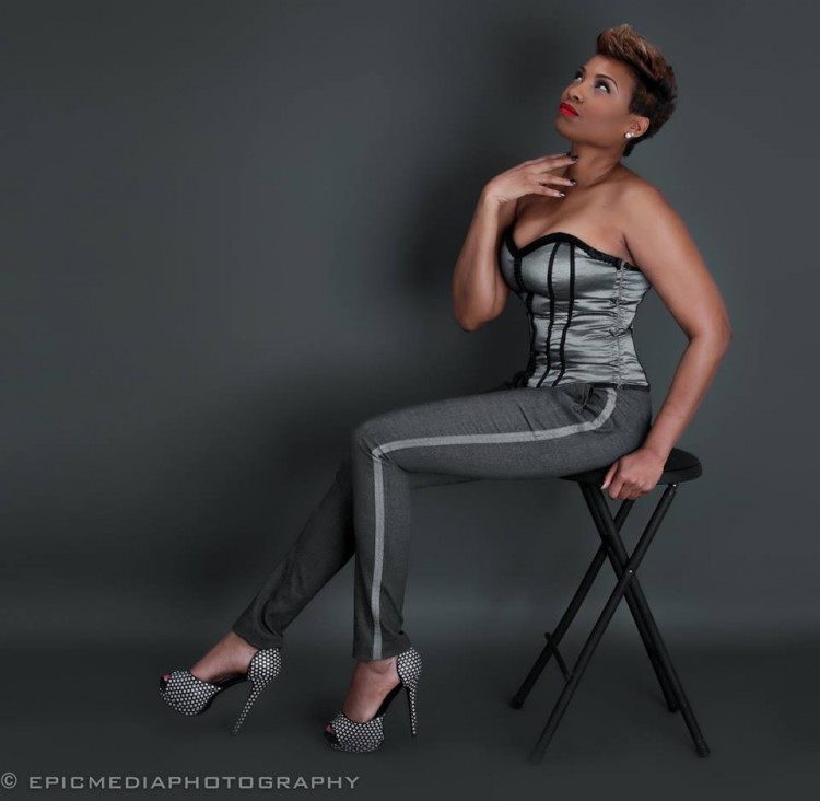 woman sitting on chair modeling an outfit
