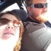 Man and woman wearing sunglasses in a car