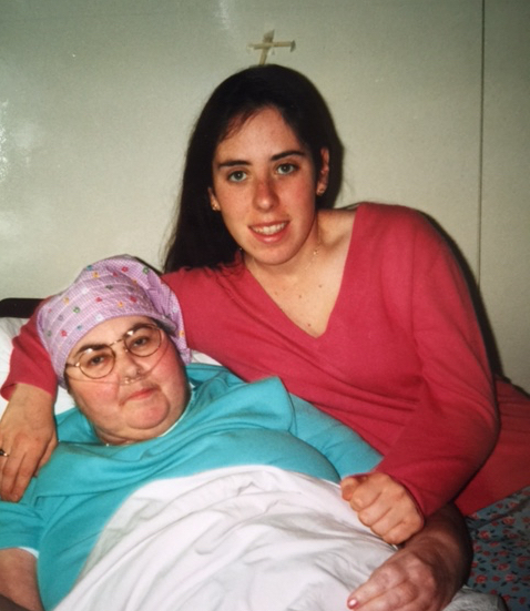 woman on bed with her daughter