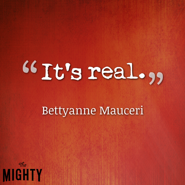 "Red background which reads ""It's real."" Bettyanne Mauceri"