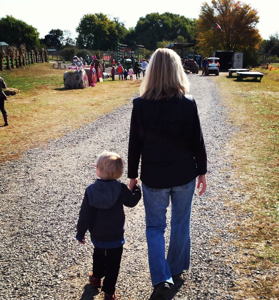 Mom and son walking at the zoo