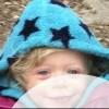 Girl wearing blue hoodie with black stars