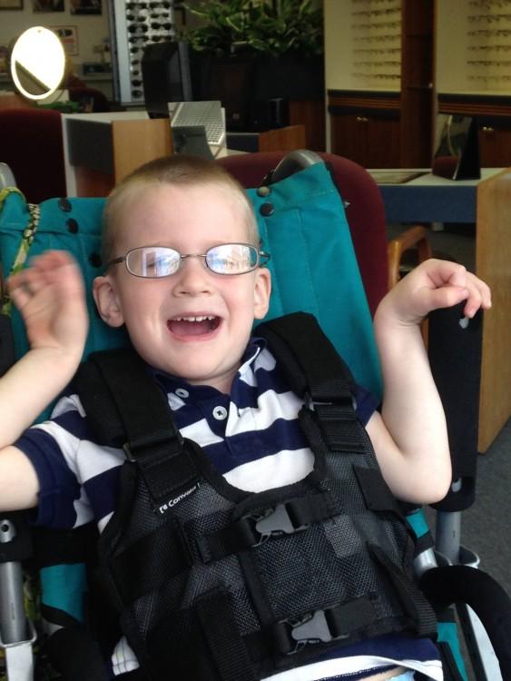boy wearing glasses in wheelchair