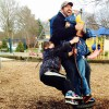 Father and son playing in a park playground