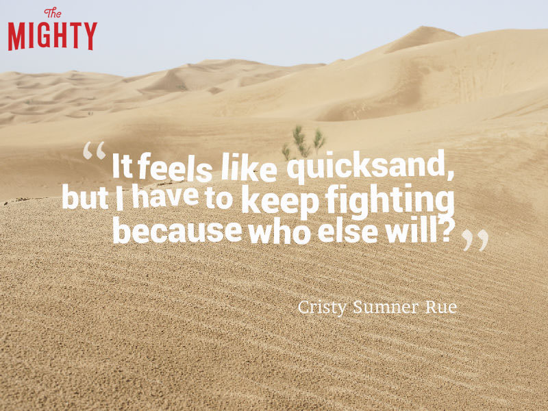 "sand with words ""It feels like quicksand but I have to keep fighting because who else will?"""