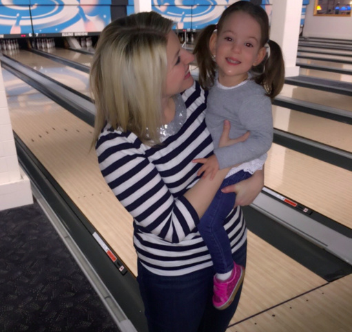 Mom and her daughter at a bowling alley