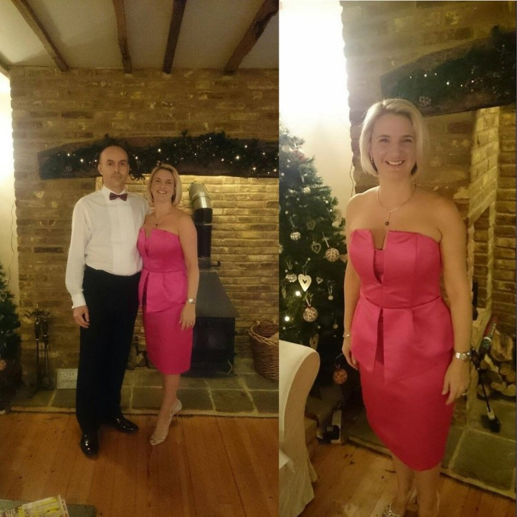 Woman in pink peplum dress