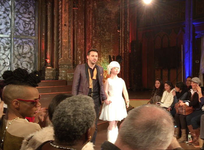 Stuart walking the runway with model