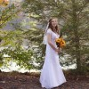 woman wearing wedding dress standing by trees