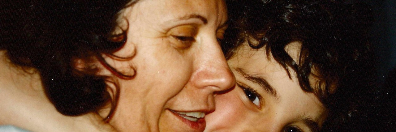 mom hugging young daughter
