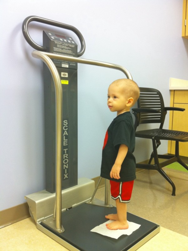 ezra standing on scale at hospital