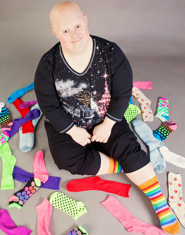 woman sitting in pile of socks