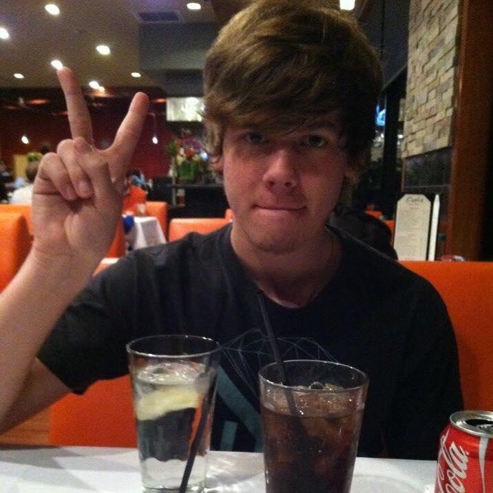 Jennifer's son, making a peace sign.