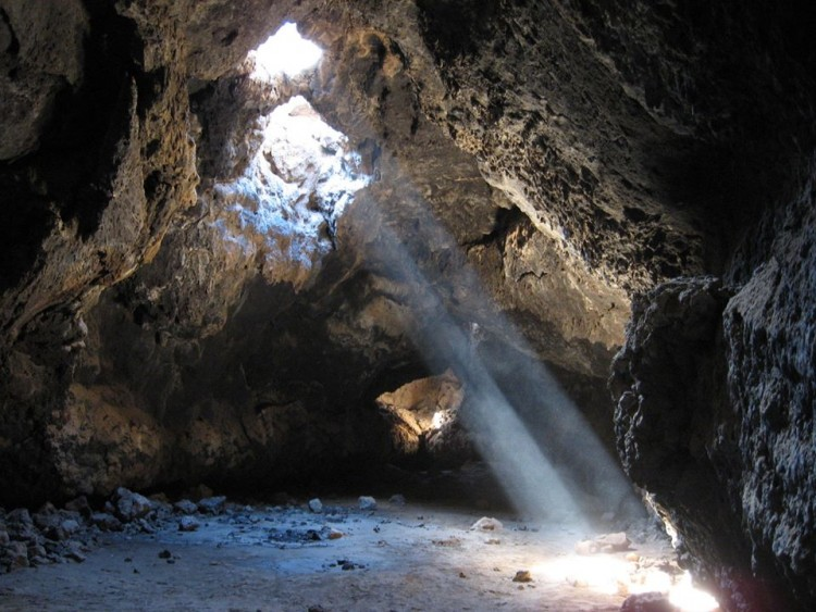 light shining through the darkness of the cave