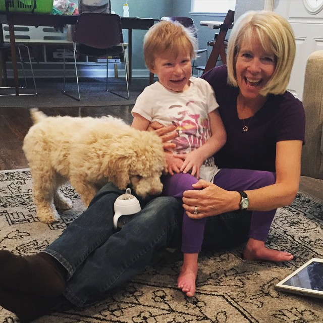 julia and her mimi and a labradoodle