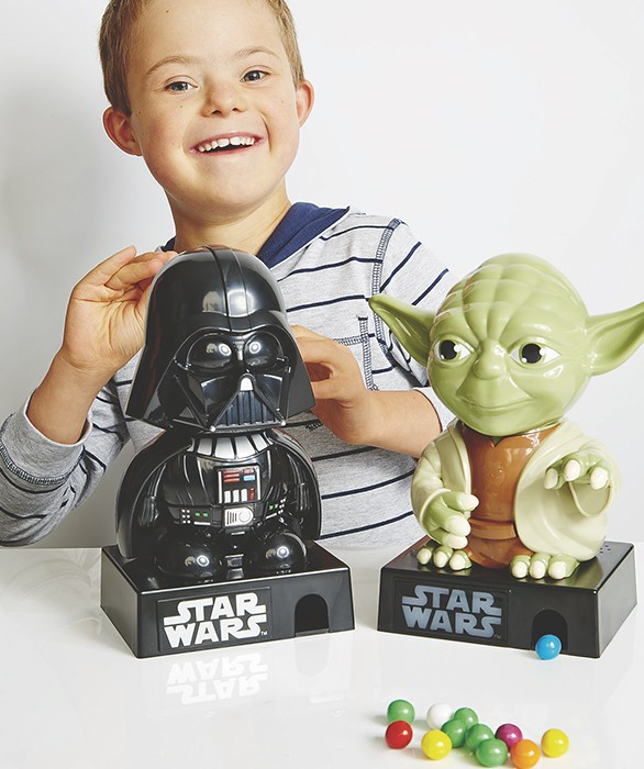 little boy with down syndrome playing with star wars toys in kmart catalog