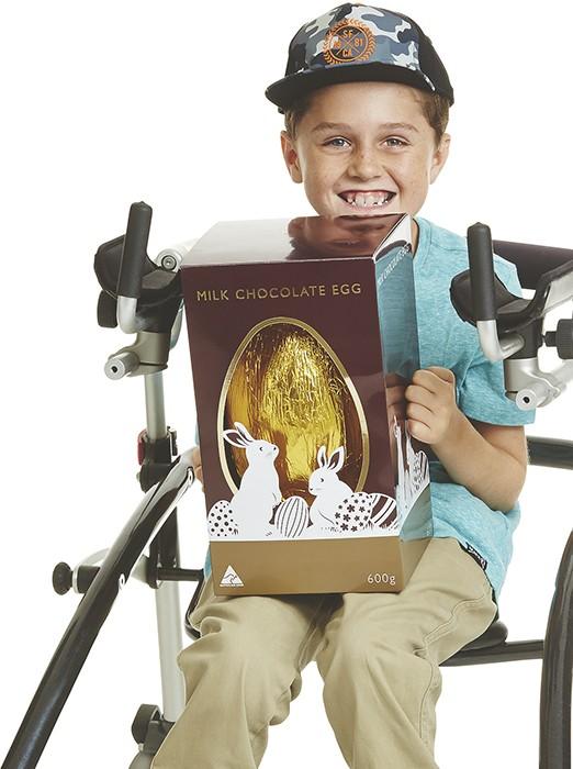 cooper holding easter egg in kmart ad