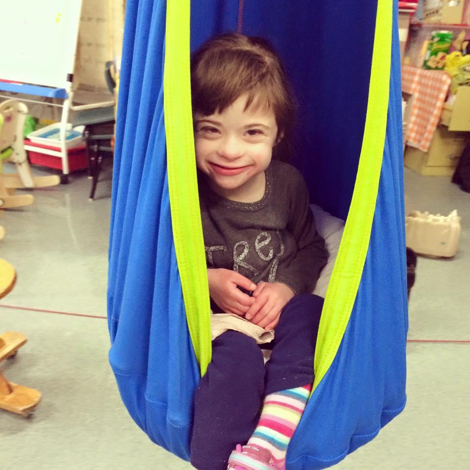 lily in a sensory swing