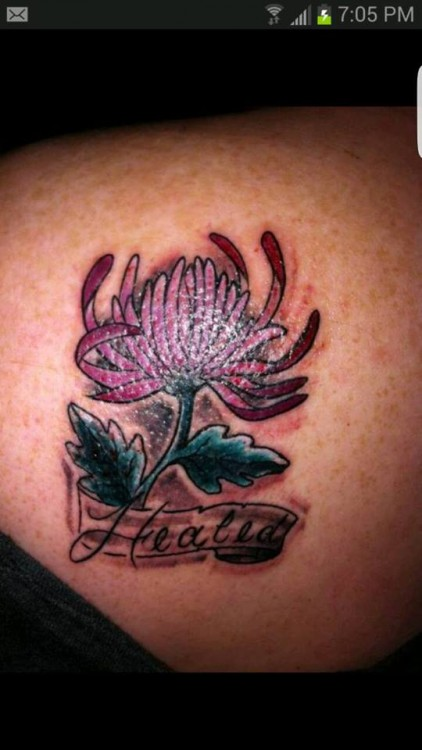 "Tattoo of a flower with the words, ""Healed"""