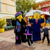 Three children play with a group of Lego characters at the Legoland Resort in Winter Haven, Florida.