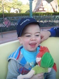 boy wearing baseball cap and smiling