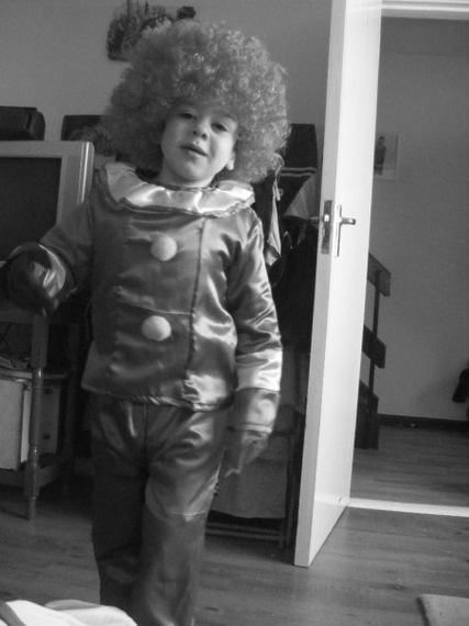boy wearing costume and wig
