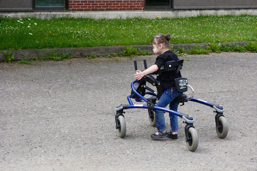 Girl using her walker outside