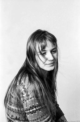 Black and white photo of Jasmine, smiling slightly.