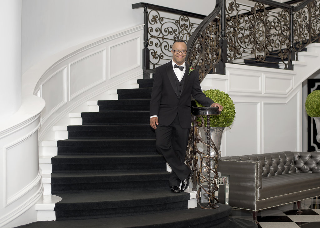 young man in tux on stairs