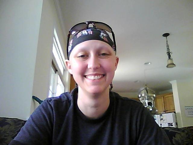 woman smiling wearing bandana and sunglasses