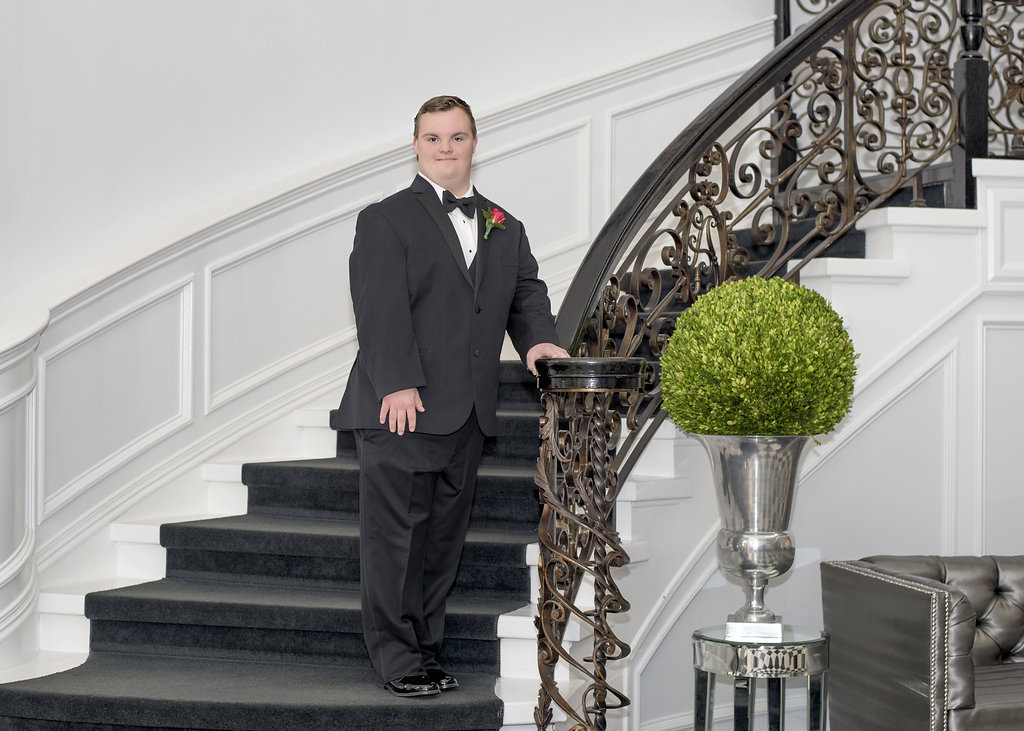 young man posing on stairs