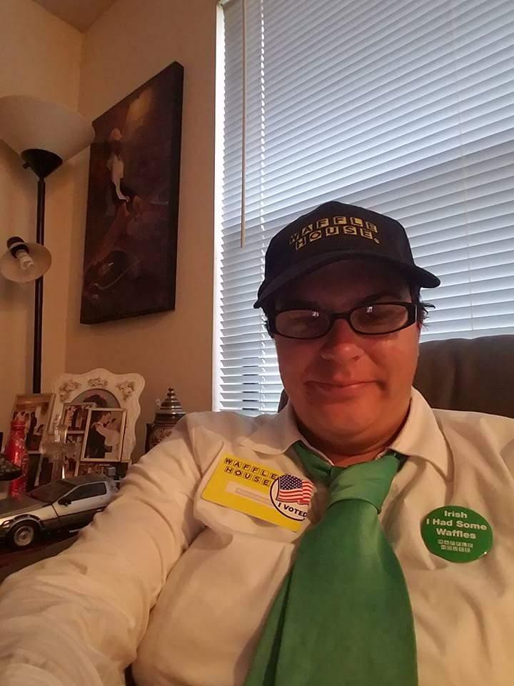 author wearing waffle house uniform