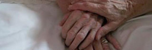 three women's hands on bed