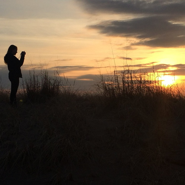 Taking a photo at sunset
