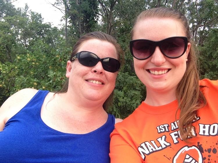 mom wearing blue tank top and daughter wearing orange shirt