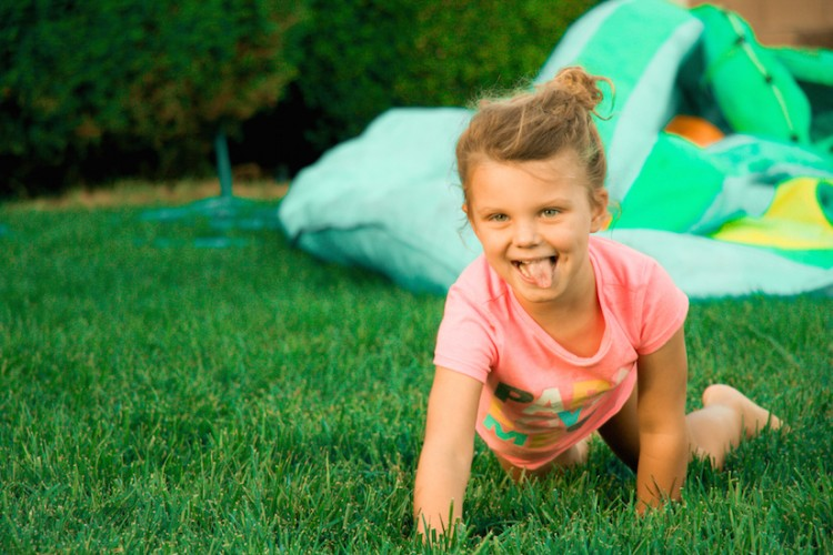 girl crawling on grass