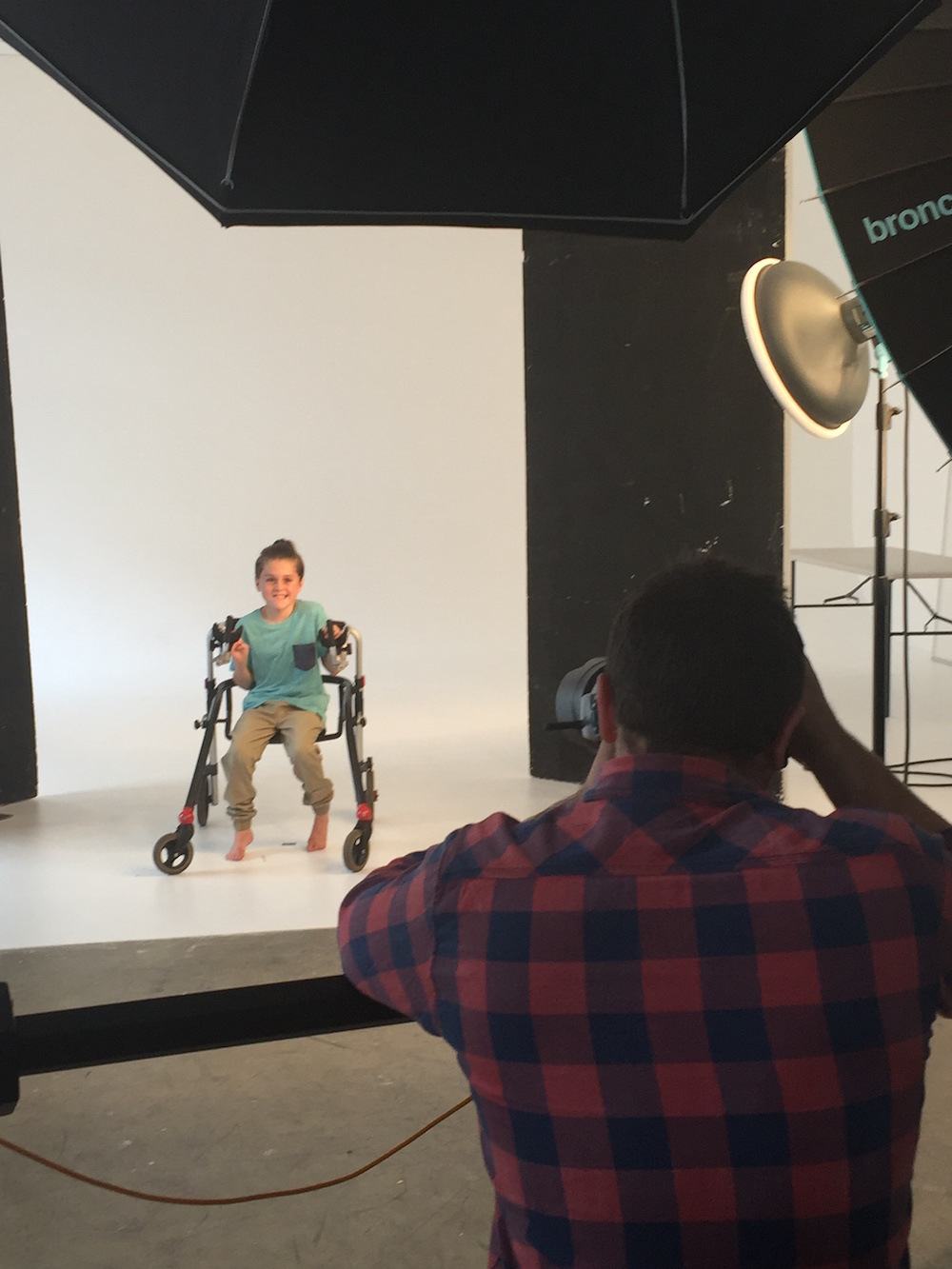 cooper being photographed for kmart