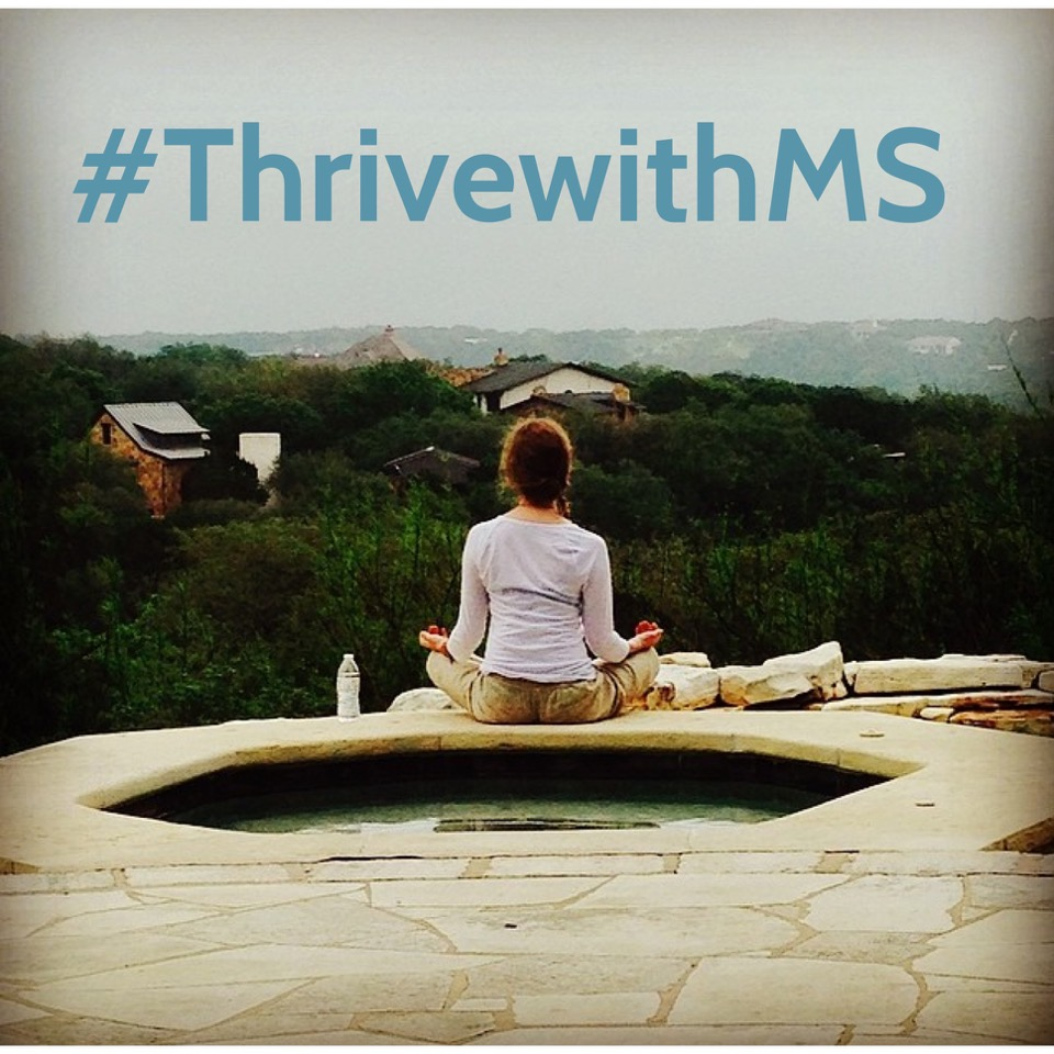 Woman meditating in front of a green city landscape with the text #ThrivewithMS