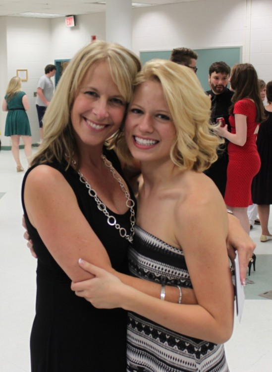 Kelly and her daughter, Brooke, embrace