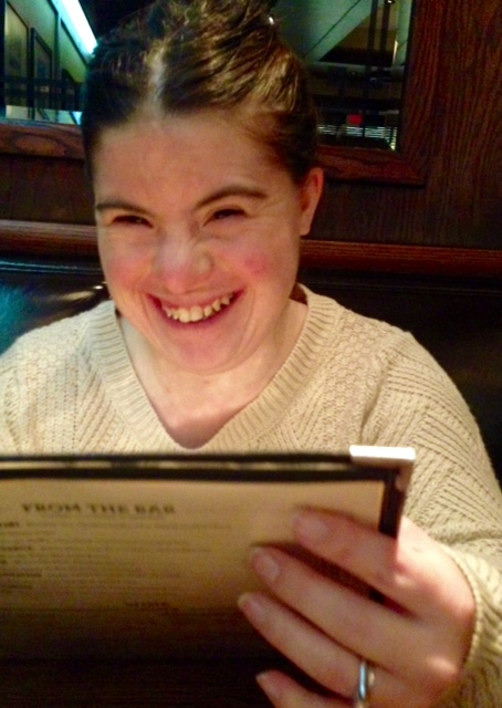 girl holding menu and smiling