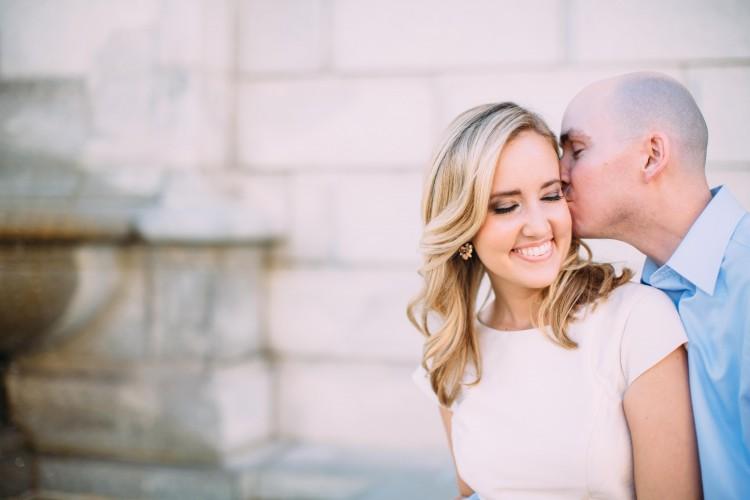 engagement photo of man kissing woman