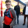 little boy wearing nesel backpack