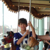 author's son on a merry go round