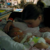 mom with baby in nicu
